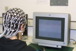 Participant with EEG head net taking part in the study.