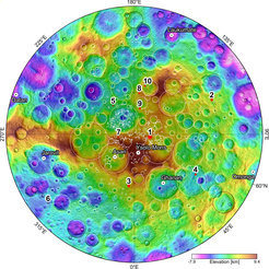 <p>View of the North Pole: The colours show the varying height of Ceres' landscape. The numbers refer to ten craters where the Framing Cameras built in Göttingen at the Max Planck Institute for Solar System Research have discovered water ice.</p>