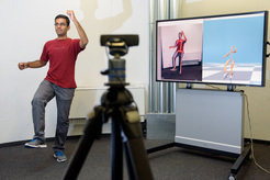 <p>Srinath Sridhar from the Max Planck Institute for Informatics demonstrates how well VNect already works: based on images of an inexpensive webcam, the system can caclculate a three-dimensional model of the doctoral student's body poses in real-time.   </p>