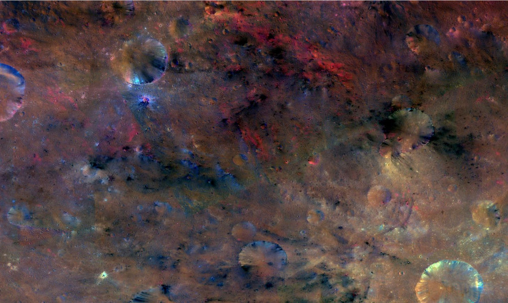 <p>Crater Sextilia, 135°O/30°S: this colourful image from NASA's Dawn mission shows material northwest of the crater Sextilia on the giant ast