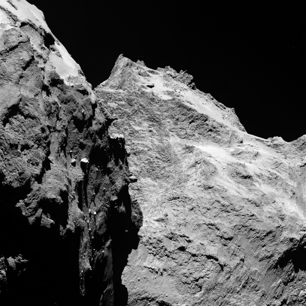 "Jagged cliffs and prominent boulders: In this image, several of 67P's very different surface structures become visible. The left part of the images shows the side wing of the comet's ""body"", while the right is the back of its ""head"". The image was taken by OSIRIS, Rosetta's scientific imaging system, on September 5<sup>th</sup>, 2014 from a distance of 62 kilometers. One pixel corresponds to 1.1 meters."