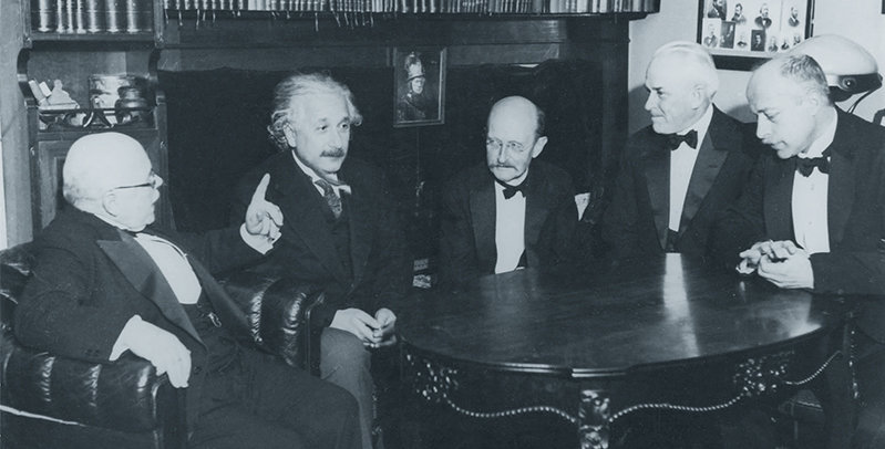 "The institute was founded under the name ""Kaiser Wilhelm Institute for Physics"" during WWI. The newly founded institute was first housed in Einstein's private living quarters before moving to its own building in Berlin-Dahlem in 1937. This illustrious round shows Walther Nernst, Albert Einstein, Max Planck, Robert Millikan and Max von Laue in 1928 (from left to right)."