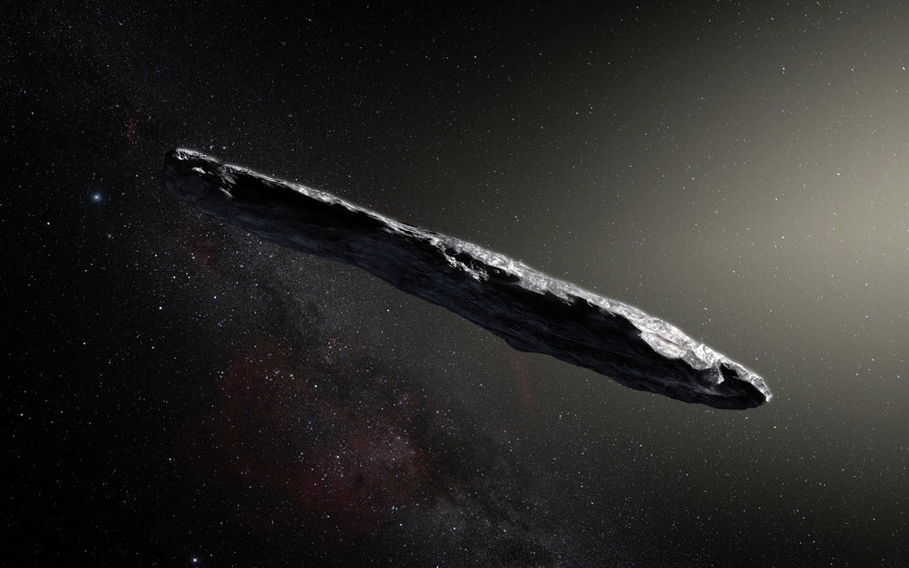 Artist's impression oft he interstellar object 'Oumuamua. The object is either elongated as in this image, or else shaped like a pancake.