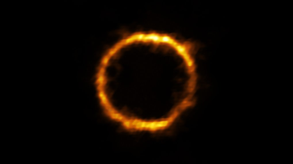 Kosmischer Ring: Astronomen haben eine extrem weit entfernte und daher sehr junge Galaxie entdeckt, die unserer Milchstraße überraschend ähnlich sieht