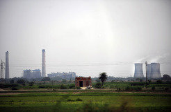 Delhi's power stations release the bulk of various pollutants into the air. To reduce the number of power outages,more stations are planned, for example here on the undeveloped land in the foreground.
