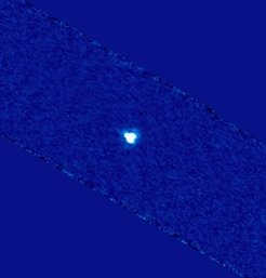 This image of the minor planet 2005 YU55 at a wavelength of 70 micron was reconstructed from more than 3500 individual exposures with the <i>Herschel</i> space observatory. The shape of the image shows the point spread function of the telescope, the asteroid itself is too small to be resolved with <i>Herschel</i>