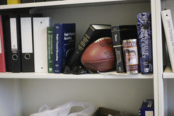 Sam Young always has his work tools from a previous life at hand: a football on the shelf ...