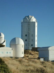 <p>The observatory in the high-rise: Gregor is housed under a retractable dome on the roof of the building.<b> </b>The astronomers operate the telescope and scientific instruments from a control room on the third floor of the building. <b></b></p> <p>  </p>