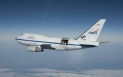 "<p>SOFIA, the ""Stratospheric Observatory for Infrared Astronomy"" cruises above Southern California with its large cavity door wide open; the 2.7-meter German-built telescope is visible. At altitudes of up to 45000 ft the observatory operates above 99.8% of the atmospheric water vapour.</p>"