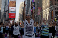 People gathering in New York City's Times Square to salute the sun at the summer solstice. Ancient spiritual teachings such as yoga are very popular in the western world. But many of its spiritual elements and ideas have disappeared on the way to modernity.