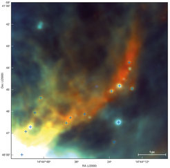 "A glance into a cosmic birthplace: on this false-colour image of the molecular cloud IRDC316.72+0.07 each ""+"" symbol indicates the presence of a cloud core where a new star will probably be formed. Astronomers have observed this early phase of star formation with the Herschel Space Telescope for the first time; the image is based on infrared data taken with the PACS onboard instrument. The three colours represent three different wavelengths in the far-infrared range: 70 micrometers (blue), 100 micrometers (green), and 160 micrometers (red)."