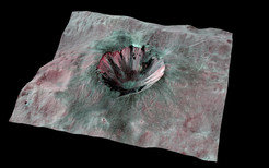 In this three-dimensional image of one of Vesta's smaller craters, the dark material can be seen within the crater.