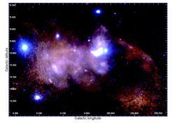Zoom into the centre: magnified image of the central 100 light years of the Milky Way centre, where here only the soft X-ray emission is shown. The Galactic black hole and its surrounding emission are located in the brightest central region of the image, and the bipolar lobes appear above and below that location.