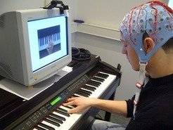 The researchers used an electroencephalogram to record the brain waves of the pianist while he was playing.
